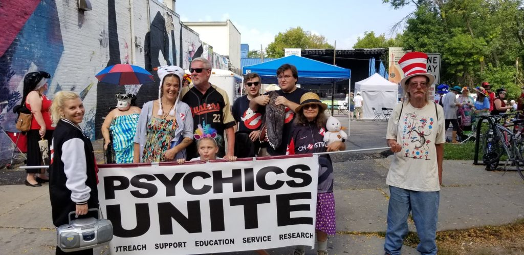 People behind a Psychics Unite banner